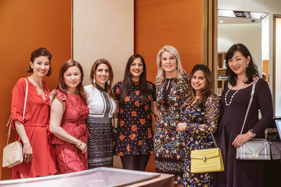Stephanie Von Stein, Dr. Sippi Khurana, and others posing for a photo at the Bulgari Galleria in Houston supporting KNOWAutism