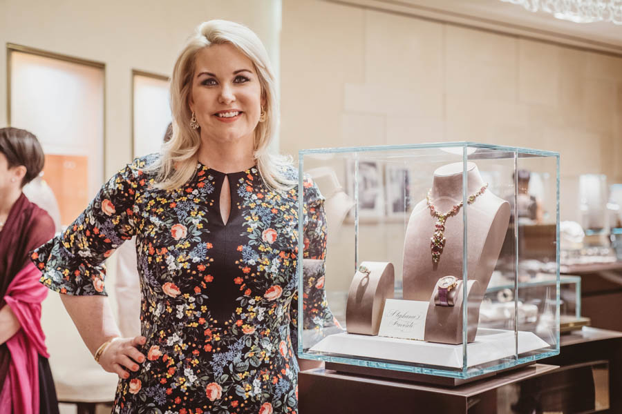 Stephanie Von Stein standing next to her jewelry selection for a charity event benefiting KNOWAutism hosted at the Bulgari Galleria Houston